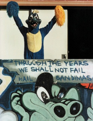 Hailing atop its throne, the San Dimas High School mascot takes advantage of an opportunity to step out of its lair for a stretch. Like graffiti embedded on a street wall, the spirit of mascot April Branam and other SDHS students is difficult to conceal. / photo by Isela Peña