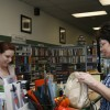 Debbie Tucker, left, assists a customer at The Book Rack. / photo by Christina Worley