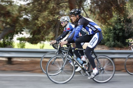John Holderness and Patrick Caro ride along on a cool Friday morning the day after Thanksgiving going eastbound on Puddingstone Drive just before the Via Verde park entrance. / photo by Stephanie Arellanes