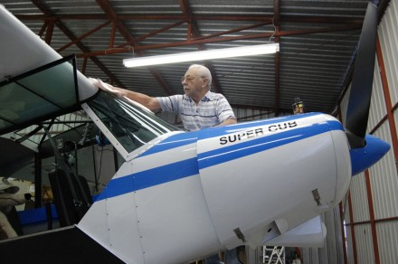 Piper Super Cub plane owner George Petterson has had numerous hangars at the airport since June of 1960. Since retiring, Petterson enjoys spending time at the airport, cleaning his plane and conversing with other pilots stationed at Brackett. / photo by Leah Heagy