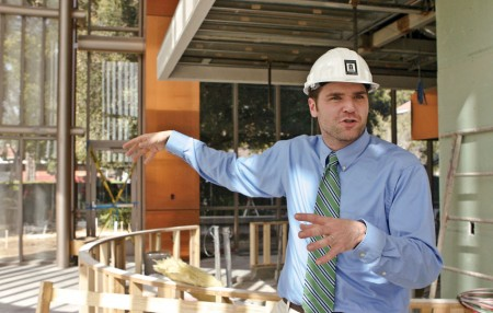 During the final construction phase of the campus center, Chip West leads hard-hat tours of the new building and gives a description of the use for each space. West is executive director of the campus center and of capital planning for the University of La Verne. / photo by Rhiannon Mim