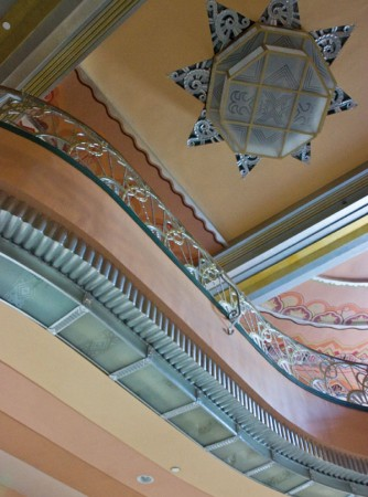 The lobby's original ceiling was covered under 12 layers of paint and was uncovered for replication of the design, which took three months to paint. With the help of the Frasier Photo Collection at the Pomona Public Library, historic photographs were used to replicate the chandeliers which were hand-made and cost $40,000 each. / photo by Rhiannon Mim