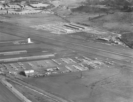 An aerial shot of Brakett Field Airport from the mid-1960s shows the airport with just one runway and little development. George Petterson, who provided the photograph, owned Brackett Aircraft Service Inc. that built the first 40 tee hangars at the airport. / photograph courtesy of George Petterson