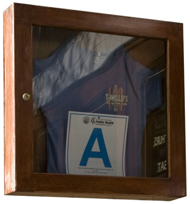 "With boastful pride, the La Verne management of T. Phillips Alehouse & Grill on ""D"" Street keeps its coveted Health Department ""A"" rating in a locked display cabinet. / photo by Michael D. Martinez"
