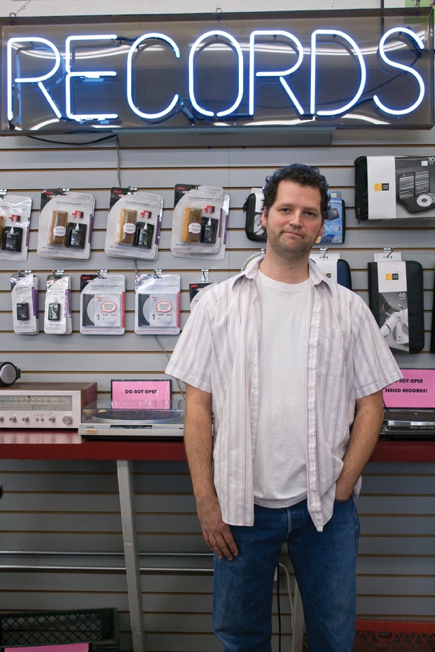 General manager of Rhino Records in Claremont for more than 20 years, Dennis Callaci has seen the rise and fall of musical trends. His store holds analog treasures while also meeting the demands of the digital music enthusiast. / photo by Michael D. Martinez