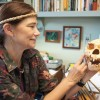 A human skull tells its story of cannibalism in the hands of Felicia Beardsley. The La Verne associate dean and associate professor of anthropology has a significant collection of artifacts from her two decades of anthropological discovery in Micronesia. / photo by Christopher Guzman