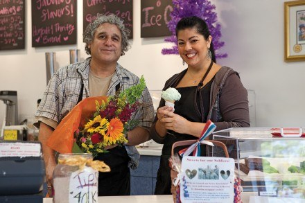 Floral designer John Nogales and co-owner Sharon Trejo show off the offerings of the Sweet Shoppe. Sharon manages the ice cream and candy, and makes the homemade fudge. John, a floral designer for 15 years, oversees the flower shop and its arrangements. / photo by Garrett Gutierrez