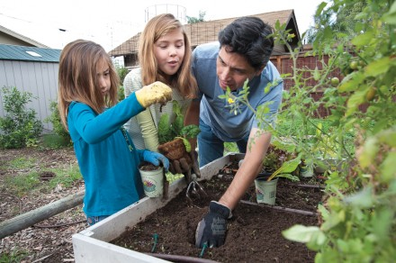 Gardening is a family affair for Chuck Duffie and daughters Nara, 7, and Hanako, 9. The Duffies, who contribute their vegetables to the Beta Center food bank, say their cherry tomatoes were their main summer harvest. / photo by Nicholas Mitzenmacher