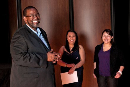 Taking a break during a rehearsal for the Ann and Steve Morgan choral concert, choral director James Calhoun, with chamber singers Jennifer Ramirez and Melissa Emralino, discuss moves associated with the performance of Sir Duke by Stevie Wonder. / photo by Christopher Guzman