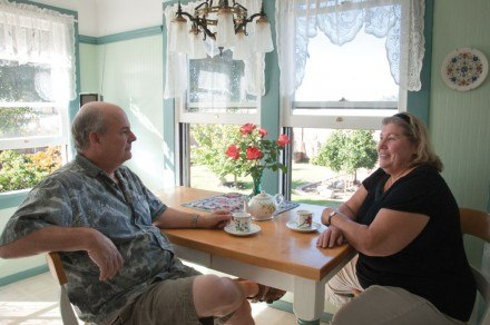 John and Sherry Best, owners of the Bradford House, enjoy spending time together in their breakfast nook, their favorite room. From here, they enjoy a view of their garden where they grow vegetables and breed chickens.