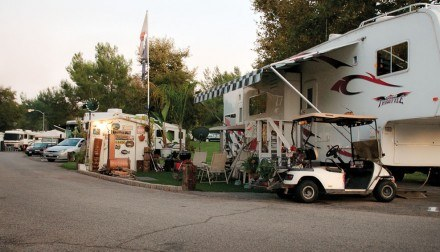 They come for a day and sometimes stay for a lifetime. East Shore RV Park at Puddingstone Lake offers both permanent and temporary lots for recreational vehicles. Fees vary depending on location. / photo by Warren Bessant