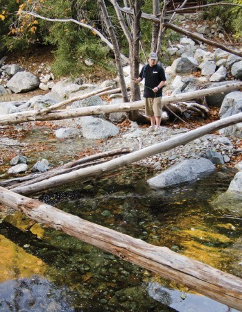 Casting his luck, Joe Fallavolita, of Claremont, 25, fishes for brown trout at his secret Mount Baldy fishing hole.