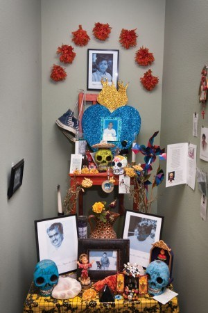 Celebrating his life, the Armas family keeps a permanent altar on display in their La Verne store in remembrance of son Carlos Jose. / photo by Scott Mirimanian