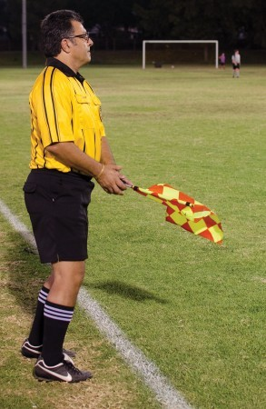 Wearing and waving the colors of soccer authority on a San Dimas High School field, Avo referees a AYSO Region 112 game. As an AAIC student, he played on the La Verne soccer team, then coached by John Gingrich, former Arts and Sciences dean. / photo by Mitchell Aleman
