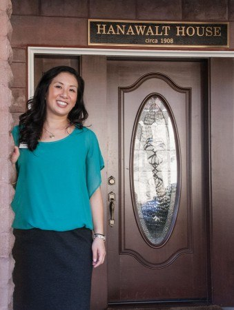 "An ever-present figure at the University she loves, Wendy Lau steps onto the porch of the Hanawalt House, one of the many places she calls ""home.""  In addition to a flourishing legal career and involvement with Phi Sigma Sigma, Wendy serves as the Board of Trustees representative on the Alumni Advisory Board. / photo by Jessica Harsen"