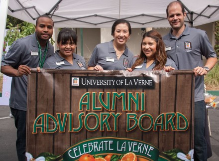 Telling the story of University pride, Alumni Advisory Board members  (from left) Wade Worthy, Julie Sanchez-Alvarez, Wendy Lau, Monserrat Cruz and Alex Lester connect with other alumni during homecoming weekend. Wendy graduated from the University of La Verne in 1998 and says the Alumni Advisory Board helps her remain connected to her alma mater. / photo by Jessica Harsen
