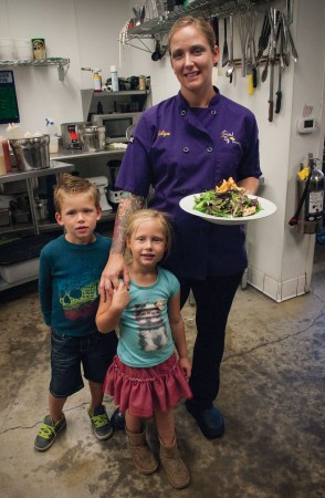 Owner and Chef Jolyn Thompson receives help from her children, Landon and Chloe Thompson, in creating a Granny Smith Apple and Goat Cheese Salad. Landon and Chloe can often be seen in the restaurant helping out. / photo by Katherine Careaga