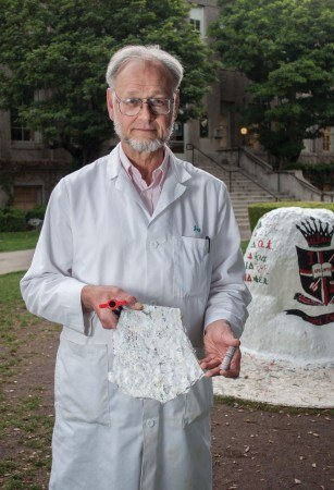 Dr. Jay Jones, professor of biology and biochemistry, has long spoken of the environmental health hazards posed by painting and repainting the rock. He has extracted paint core samples to gain a sense of how much it has grown in size. He guesses there are about eight inches of paint covering the rock. / photo by Katherine Careaga