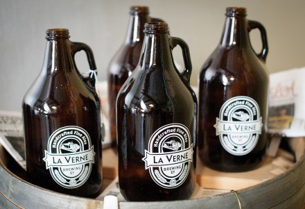 he front room of the La Verne Brewing Company contains a bar, a couple of televisions and six different beers on tap. At the bar, one can order a pint of a favorite brew or fill up an entire growler, which is 64 oz., to take home. / photo by Hunter Cole