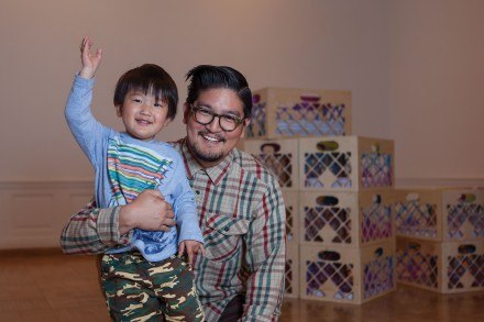 "Devon's 2-year-old son, Rui Tsuno has grown up around the art scene with weekly art exhibitions, museums, art classes and gallery openings. The piece behind them is titled ""L.A. Watershed Relocation."" / photo by Keenan Gilson"