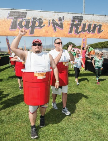 Sports marketing firm Jam Active organized the Tap 'N' Run 4k race. Runners outfitted in ridiculous costumes ran the course while intermittently stopping to chug beers. Jose Rivas and Jeffrey Serra wore red Solo cup costumes throughout the race. / photo by Hunter Cole