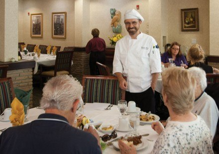 Although Chef Christian Laire has worked in many restaurants throughout his life, he says he prefers working at a place where he can see the same people every day. Christian visits with Hillcrest's residents during dinner and outside the dining halls, always ready to offer a hug and kind greeting. / photo by Katie Madden