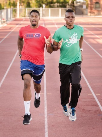 Chancise Watkins (left) runs with senior University of La Verne Track and Field teammate James Francis, demonstrating Paralympic Guide Running. / photo by Emily Bieker