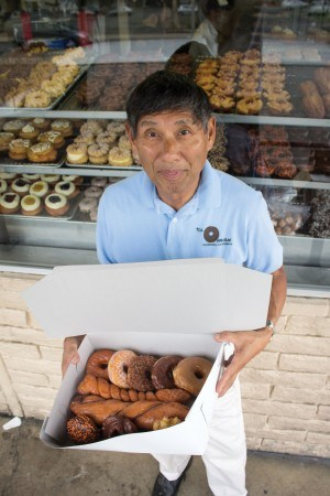 Jim Nakano opened  The Donut Man 42 years ago. Since then, his Glendora store has become a go-to place on Route 66 and is known widely by many repeat visitors. Jim's  legendary pastries have been featured on the Food Network and The Cooking Channel. / photo by Julian Mininsohn