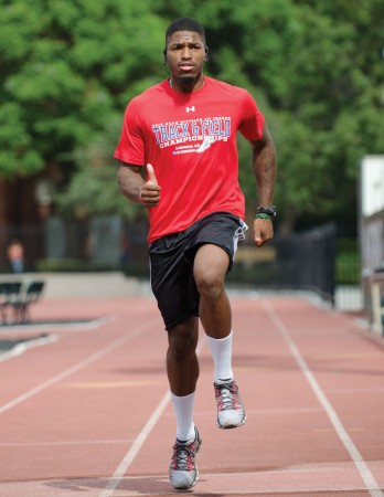 Chancise Watkins runs sprint drills such has high-knees, butt-kicks and various skips on the University of La Verne track as part of his dynamic warm up. These sprint drills allow Watkins to work on running form, breathing patterns and loosening his muscles. / photo by Emily Bieker