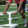 Chancise Watkins repetitively pushes a non-weighted sled 50 yards in order to work on speed endurance after running several 150 10/12 meter sprints. / photo by Emily Bieker
