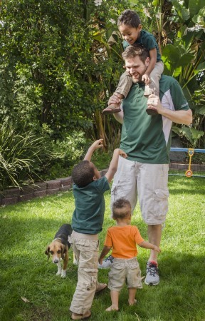 Chip West and three of his sons, Eli, Ethan and Chase, play in their backyard. After a busy day at ULV, Chip is excited to go home to his family. On the weekends, he tries to do as much as he can with his children to keep them active and involved. / photo by Alexandra Arkley