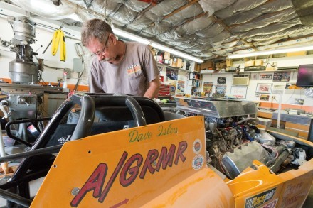 Dave Isley built his car in his garage. He has done everything from building and modifying the engine to molding the body out of fiberglass with the help of his son. He spends much of his own time, energy and money on the car. / photo by Helen Arase