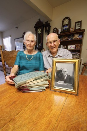 Virginia Stark-Davis and Chuck Davis, the remaining children of C. Ernest Davis, find a school play program their father kept in one of his diaries. C. Ernest Davis, who was president of La Verne College from 1938 to 1948, kept a diary from his boyhood to the day he died. / photo by Kristina Bugante