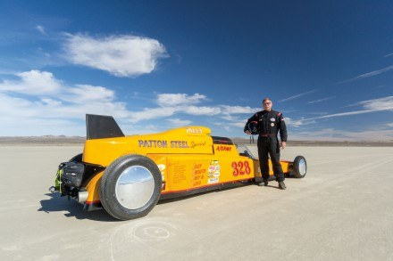 At El Mirage Dry Lake, Dave Isley wears his flame-retardant racing suit. He is the sole driver of Isley Motorsports and an active participant in the Southern California Timing Association. Each season, there are six land-speed racing events at El Mirage and two more at Bonneville Salt Flats outside of Wendover, Utah. The last few years, Bonneville and some events this season at El Mirage have been cancelled due to rain. The Bureau of Land Management closes the lakebeds to protect them from damage from recreational activities. / photo by Helen Arase