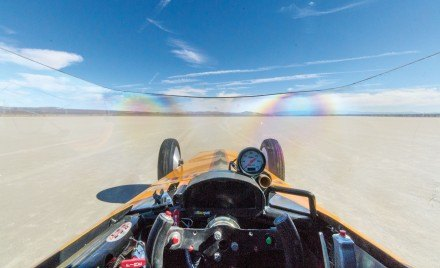 The driver's wide view of the lakebed from The Patton Steel Special is low and cramped. On the 1.3 mile course at El Mirage, Dave reaches roughly 250 miles per hour. On the five-mile race course at Bonneville Salt Flats, his goal is to break 300 miles per hour. / photo by Helen Arase