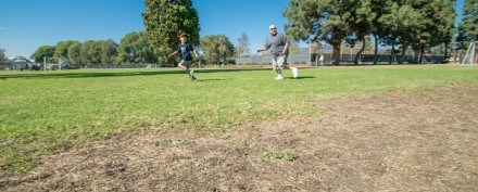 While others are competing in soccer games, La Verne Heights student Owen Hughes and his brother Justin Hughes relax on the weekends by playing football together at Las Flores Park. Areas of Las Flores Park are starting to dry up, possibly due to city water restrictions. / photo by Nanor Zinzalian