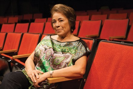 Alma Martinez takes a seat in the Dailey Theatre. Alma is an active actor, teacher, director and is a member of the Academy of Motion Picture Arts and Sciences. / photo by Terrence Lewis