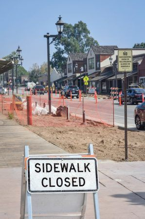 Replacement of the San Dimas boardwalks requires closing the sidewalks for safety. Some store owners say construction has reduced the number of customers who come into their stores. The project continues into the 2017 winter months on Bonita Avenue between South San Dimas and South Monte Vista avenues. / photo by Sarah VanderZon
