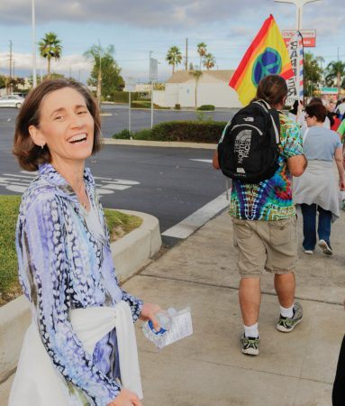 Zandra Wagoner, University of La Verne interfaith chaplain and member of the Inland Valley Interfaith Network, shows her support of peace between all religious and non-religious groups on Foothill Boulevard near Towne Avenue during the annual Interfaith Peace Walk in Pomona, Oct 16. / photo by Annette Paulson