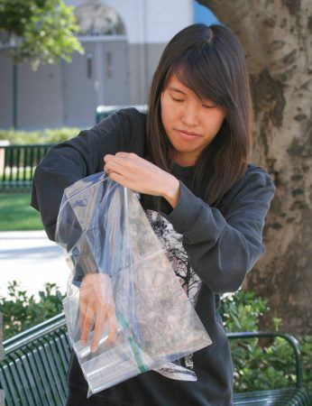4 When the tubes are filled, La Verne Magazine writer Emily Lau places them in the plastic bag provided with the kit. The tubes are then mailed back to KAR Laboratories for analysis. / photo by Taylor Bolanos