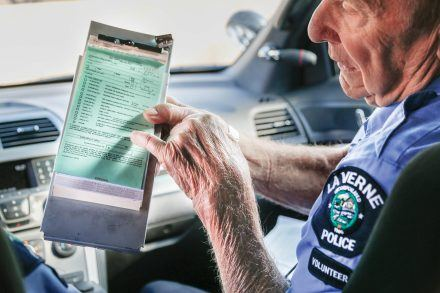 At the beginning of his shift for the RSVP, Norm Faustini reviews how to successfully fill out a parking citation. He also explains that payments must be made within 21 days of the violation date. / photo by Amanda Duvall