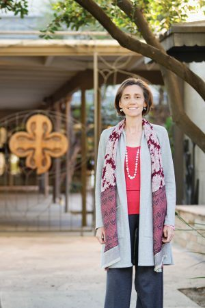 Zandra Wagoner, University of La Verne interfaith chaplain, grew up in the La Verne Church of the Brethren, located on Bonita Avenue and D Street. A quatrefoil hangs on the Church gate leading to the patio. It is a symbol that recognizes four evangelists of the Bible: Matthew, Mark, Luke and John. / photo by Annette Paulson