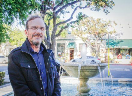 "Al Clark, professor of humanities, has dedicated more than 40 years to scholarly study of water and, in turn, educating people about the deep history of water in Southern California. The city fountain in Mainiero Square on the southwest corner of Third and D streets is often used as a central point for city events. Mainiero Square is named after the late University of La Verne education professor John ""Skip"" Mainiero. / photo by Gabriella Chikhani"