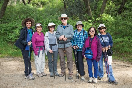 Maggie Marino, Julie Cosgrove, Donna Richenberger, Harold Richenberger, Mary Nunez, Ee Wan and Margie Garcia stand at the fork in the trail where they split up into two groups to explore the upper and lower trails of Marshall Canyon Regional Park. / photo by Taylor Griffith