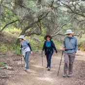 Donna Richenberger, Maggie Marino and Harold Richenberger walk on one of their favorite hikes through Marshall Canyon Regional Park. They frequent the trails there at least once a week. / photo by Taylor Griffith