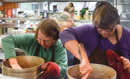 Joy Hofer (left) and Joan Blocher, volunteers from the La Verne Church of the Brethren, prepare dinner for the Food Network. The monthly event is scheduled for the third Tuesday in the Church Fellowship Hall. / photo by Nadira Fatah
