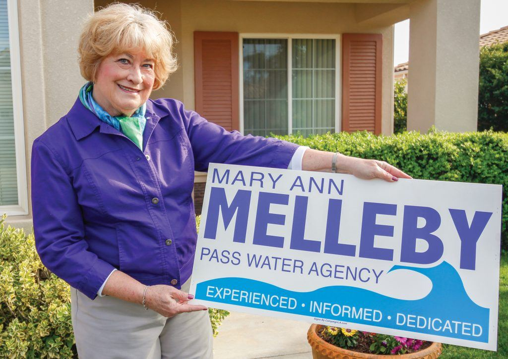 Mary Ann Melleby holds the sign she used in her successful campaign to be elected  to the Board of Directors of the San Gorgonio Pass Water Agency in November 2012. After serving a full term as ­­board treasurer, she  retired  when her term ended in 2016. / photo by Kathleen Arellano