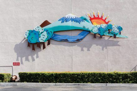 """""""Untitled,"""" by Dianne Schramm and Charles DuBay, commissioned by the La Verne Courtyard, is a painted steel piece that hangs on the rear of Orchard Supply Hardware, facing Durward Way across from the Bonita High School football field. / photo by Breanna Ulsh"""