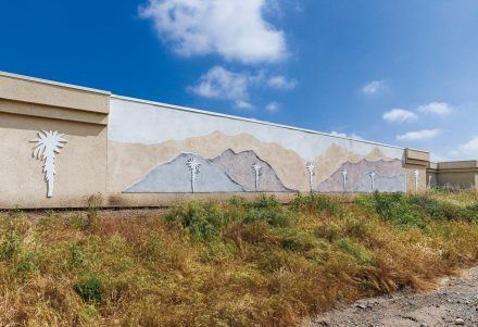 """""""Mountainscape"""" by Brian Worley, an artist with many commissions from city businesses and the University of La Verne, is located at 1960 San Dimas Canyon Road facing Arrow Highway. The piece was sponsored by Extra Space Storage. / photo by Breanna Ulsh"""