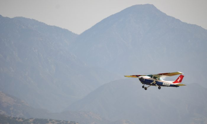 Taking off from Brackett Airport runway 26 in a Cessna, CAP pilot Captain Jeff Wells allows cadets to handle the controls while aloft for an hour as they also observe La Verne's terrain. / photo by Janelle Kluz